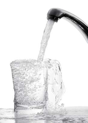 running water from tap into a glass, isolated on white